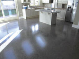 Gray polished concrete flooring in Winston-Salem, NC customer's home